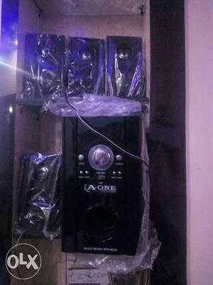 Brand New Home Theater with 4 speaker function:-