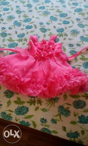 A lovely pink colour baby frock...size s for 1 to