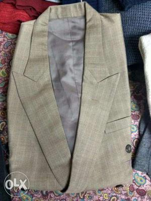 Gents Raymonds complete suit (blazer and pant)in beige
