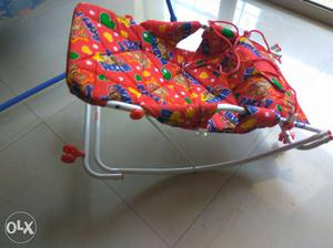 Baby's White Red Blue And Green Rocker