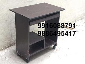 Computer table with wheels and keyboard shelf at