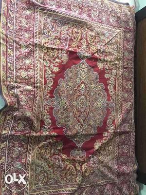 Persian silk carpet in good condition.