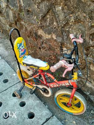 Red And Yellow Bicycle With Training Wheels