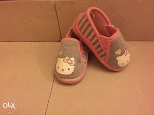 Toddler's Pair Of Hello Kitty Print Slip On Shoes and