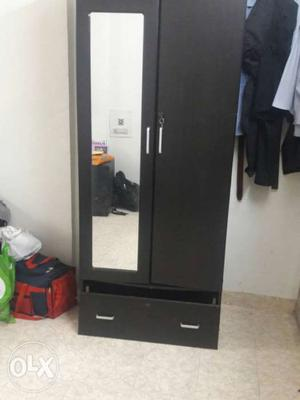 Black wooden cupboard for sale on the go