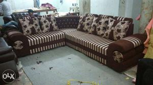 Brown And White Fabric Sectional Sofa And Throw Pillows