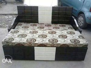 Brown And White Floral Mattress And Black And White Bed