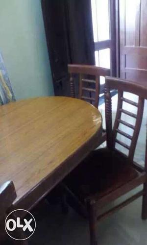 Brown Wooden Oval Table With Chairs