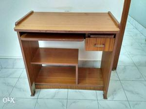 It's a computer table in good condition.