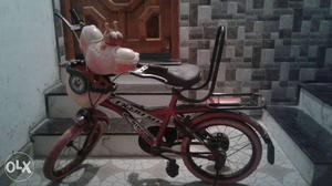 Red Bicycle With Training Wheels