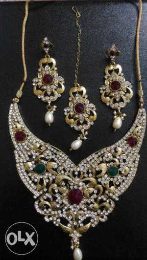 Gold And Diamond Necklace And Earrings