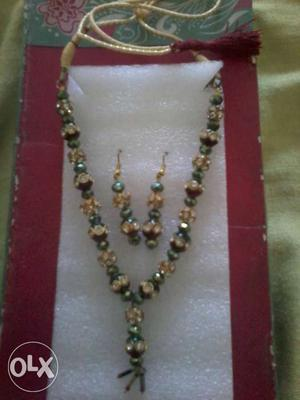 Green And Gold Beaded Necklace And Dangling Earrings
