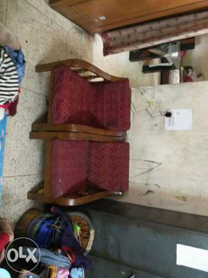 2 Brown Wooden Framed Red Cushioned Armchairs