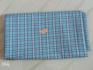 Blue And White Plaid Textile