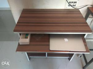 Computer table, good condition less than 1 year