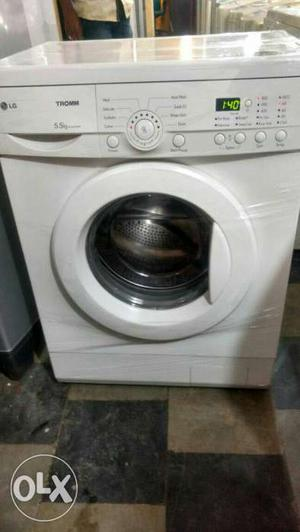 White Lg 5.5 kg Front Load Washing Machine with free home