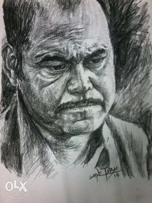 Portrait pencil sketch by charcoal