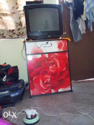 One lg tv and table.inside spece.. good condition