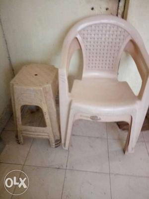 White Plastic Armchair And Plastic Stool Chair