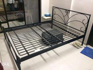 Wrought iron bed for sale.