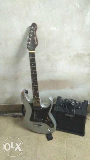 Black And Gray Stratocaster Electric Guitar With Amplifier