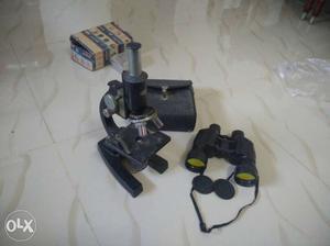 Black Binoculars And Microscope