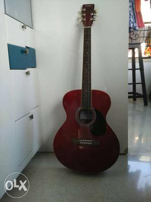 Red acoustic guitar approx 3 months old. In good condition.