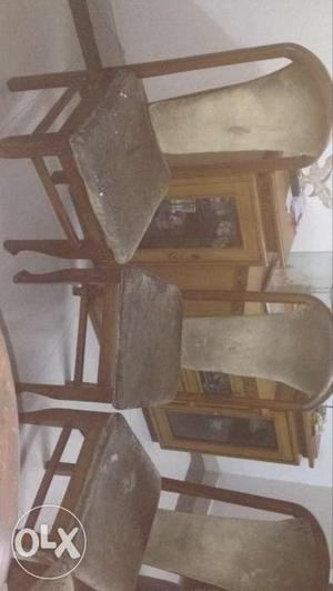 Six Brown Wooden Framed Beige Cushioned Chairs