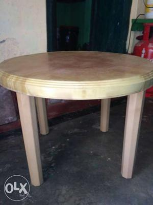 Round Beige And White Wooden Table