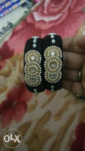 Two Black And Gold Bangle Bracelets
