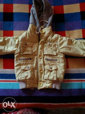 Light yellow jacket for both boys and girls,