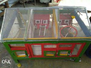 Green, Red And Yellow Wooden Chicken Coop