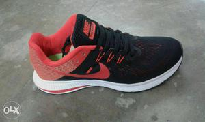 Black, Red, And White Nike Running Shoe