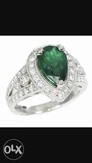 Green emrald and american diamond ring branded