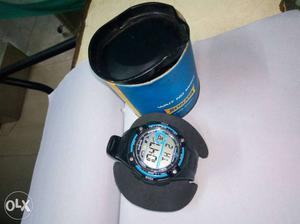 Round Black And Teal Digital Watch