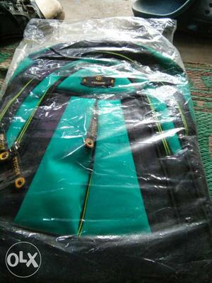 Green And Black Backpack In Package