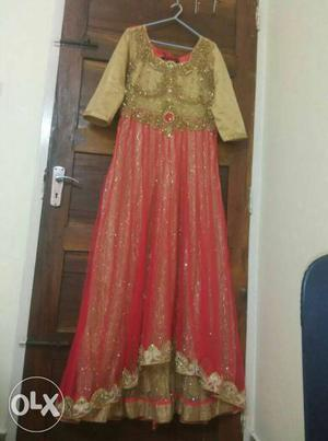 Once used carrot coloured gown with heavy stone