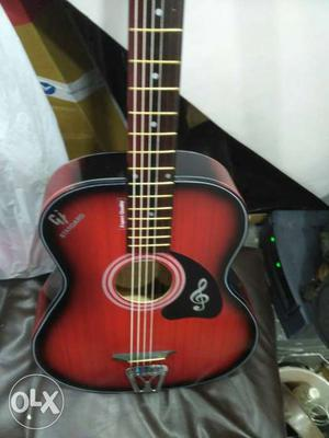 Red color acoustic guitar, 6 months warranty call