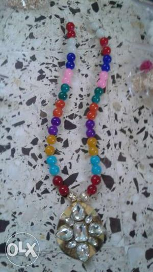 Gold And Diamond Beaded Necklace