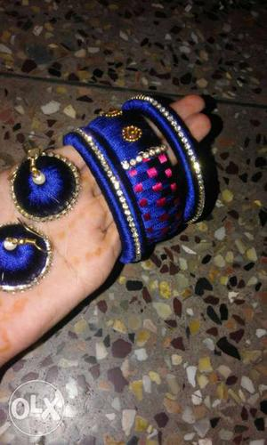 Three Blue Bangle Bracelets With Pair Of Blue Dangling