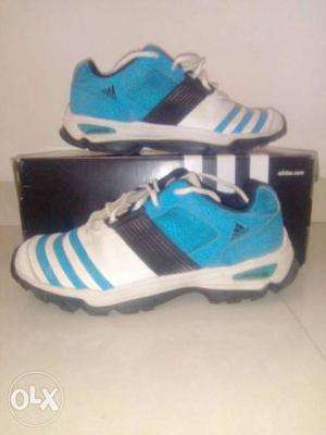 Adidas blue and white sports shoes with original