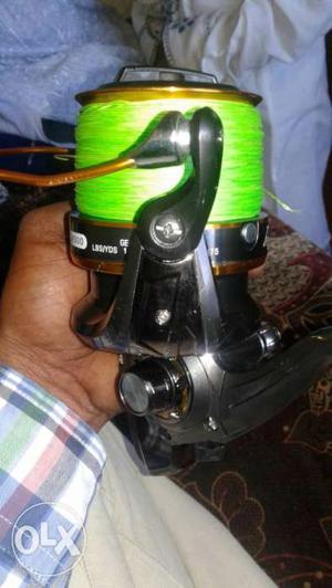 Black And Green Fishing Reel