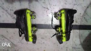 Pair Of Black-and-green Roller Skates