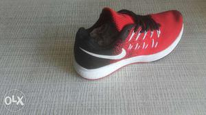 Red-grey-and-white Nike Running Shoe