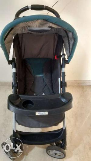 Grey colour Graco stroller with tray and basket,