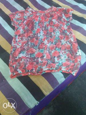 It is a red floral top. It is new and not used