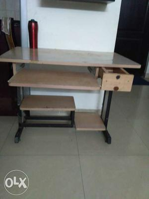 Wooden computer table in good condition.