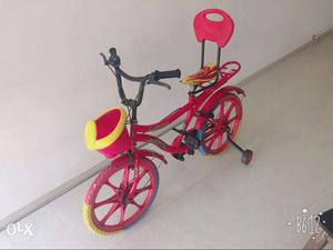 Pink Bicycle With Training Wheels