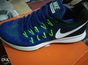 Blue, Black And White Nike Running Shoe