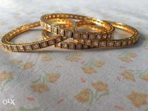 Four Gold Rhinestone Beaded Bangle Bracelets